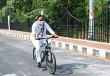 Uttar Pradesh Energy Minister using bicycle to office for environment